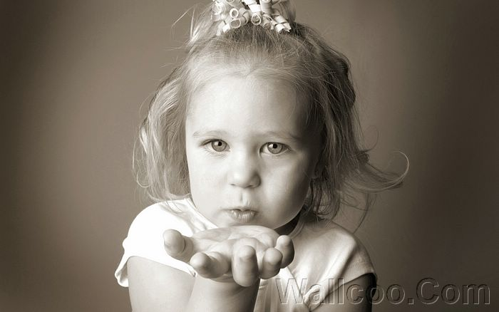 http://wallcoo.net/photography/Innocence_baby_photography/images/%5Bwallcoo_com%5D_Black_and_white_photo_of_A_baby_girl_blowing_a_kiss_ISPC006077.jpg